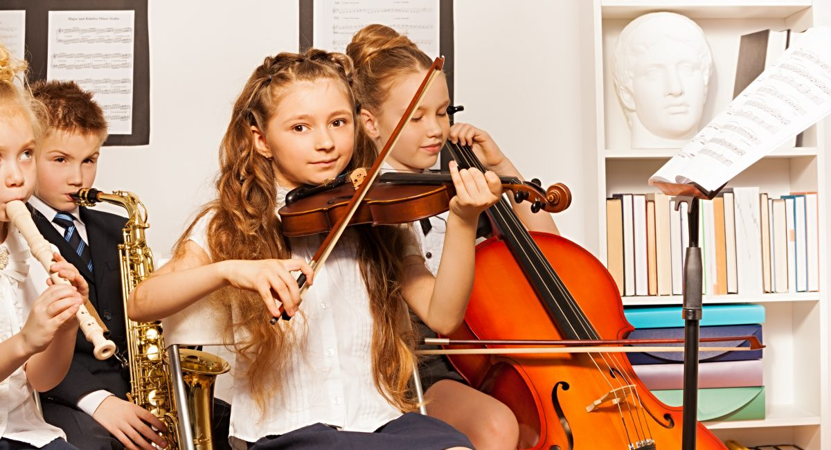 Group of kids playing musical instruments indoors_edited1